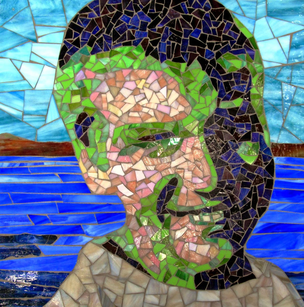 Happy Austin glass mosaic portrait by Jeannette Brossart, Durham NC