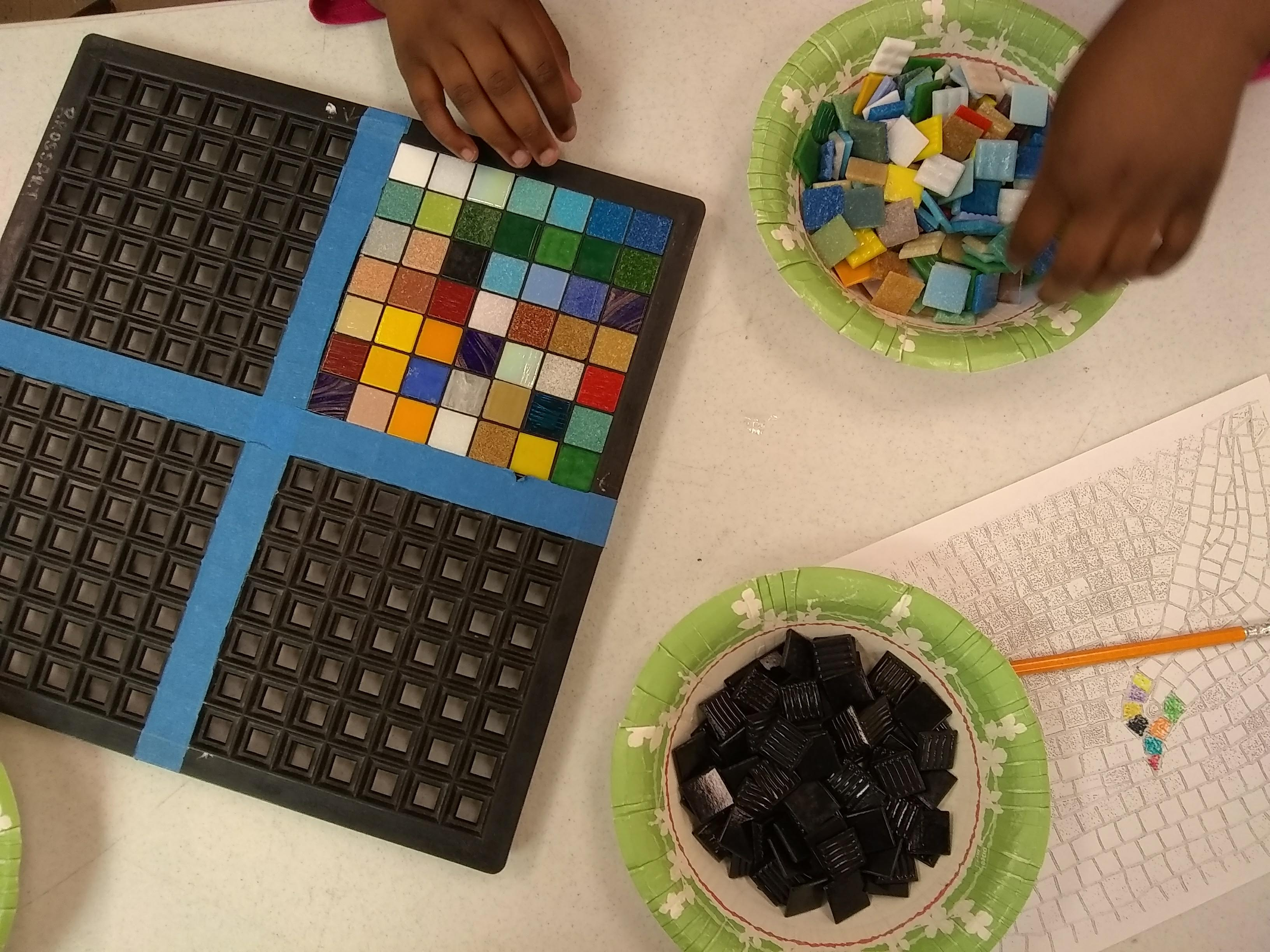 Students exploring pixel tile mosaic art and math workshop with Jeannette Brossart, NC