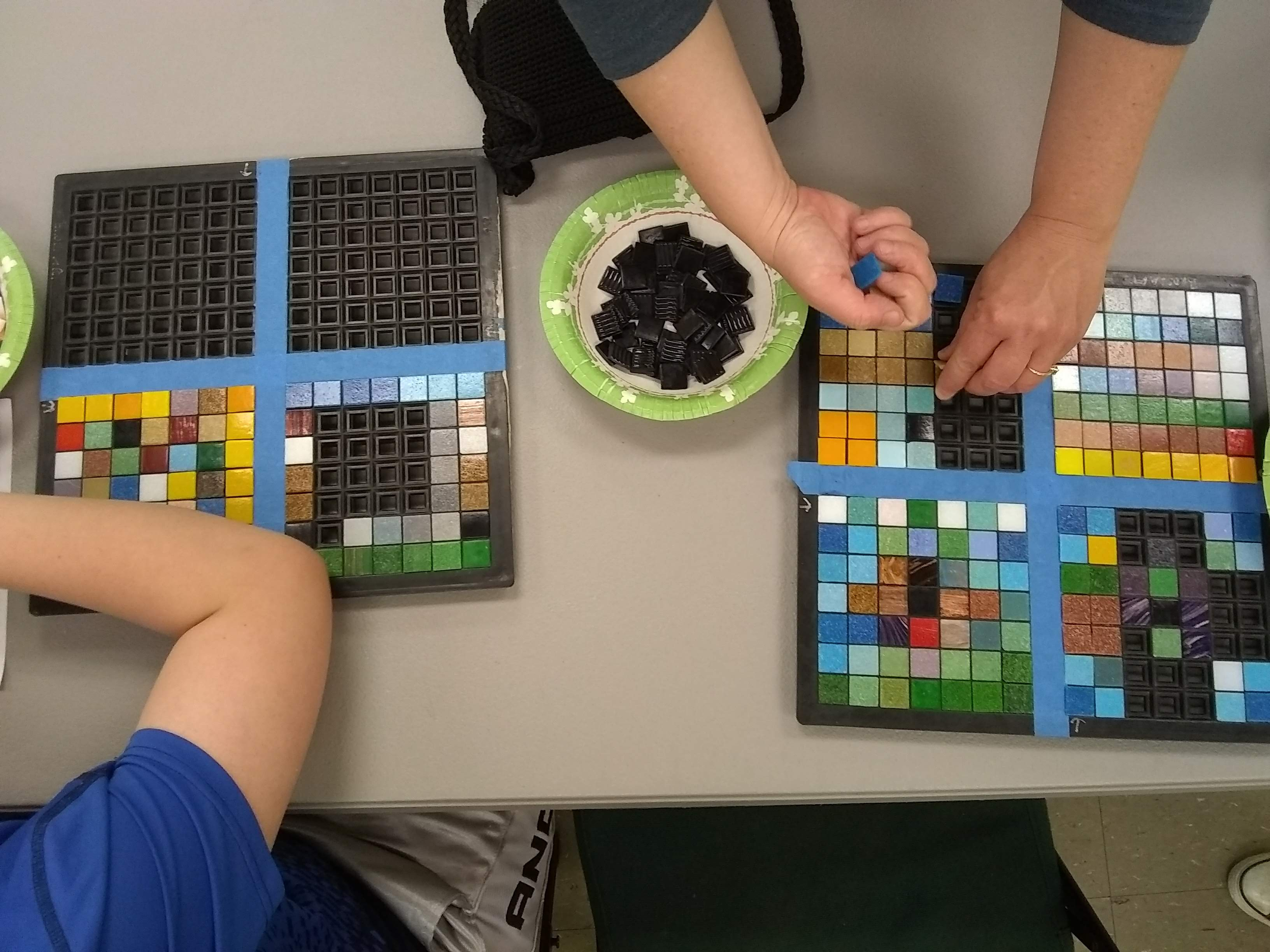 students exploring math and mosaics, with teaching artist, Jeannette Brossart, NC